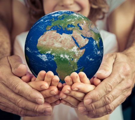 Family holding 3D planet in hands. Earth day holiday concept. Elements of this image furnished by NASA