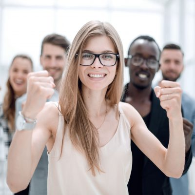 A group of business people from different ethnic backgrounds rejoices and celebrates their success in the financial and economic fields